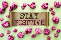 Word writing text Stay Positive. Business concept for Be Optimistic Motivated Good Attitude Inspired Hopeful written on Cardboard. Word writing text Stay Stock Images