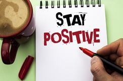Word writing text Stay Positive. Business concept for Be Optimistic Motivated Good Attitude Inspired Hopeful written by Man on Not. Word writing text Stay Stock Image