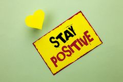 Word writing text Stay Positive. Business concept for Be Optimistic Motivated Good Attitude Inspired Hopeful written on Yellow Sti. Word writing text Stay Stock Photo