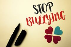 Word writing text Stop Bullying. Business concept for Do not continue Abuse Harassment Aggression Assault Scaring written by Marke. R the plain background Hearts Royalty Free Stock Photography