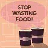 Word writing text Stop Wasting Food. Business concept for organization works for reduction food waste in society Two To. Go Cup with Beverage and Steam icon stock illustration