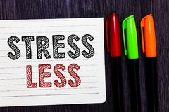 Word writing text Stress Less. Business concept for Stay away from problems Go out Unwind Meditate Indulge Oneself Notebook paper. Colorful markers wooden royalty free stock photo
