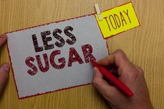 Word writing text Less Sugar. Business concept for Lower volume of sweetness in any food or drink that we eat Man holding marker p. Aper clothespin reminder Royalty Free Stock Image