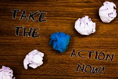 Word writing text Take The Action Now Motivational Call. Business concept for Act Start Promptly Immediate Instantly Brown woody d. Esktop four white crumpled stock images