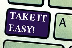Word writing text Take It Easy. Business concept for Be relaxed do not worry about things stay calmed and rest Keyboard stock images