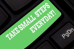 Word writing text Take Small Steps Everyday. Business concept for Step by step you can reach all your goals Keyboard key. Intention to create computer message royalty free stock photography