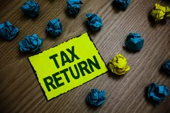 Word writing text Tax Return. Business concept for which taxpayer makes annual statement of income circumstances Yellow piece pape. R reminder lots crumpled royalty free stock photography