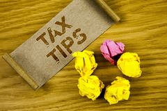 Word writing text Tax Tips. Business concept for Help Ideas for taxation Increasing Earnings Reduction on expenses Concept For Inf. Word writing text Tax Tips Stock Image