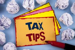 Word writing text Tax Tips. Business concept for Help Ideas for taxation Increasing Earnings Reduction on expensesConcept For Info. Word writing text Tax Tips Royalty Free Stock Photography