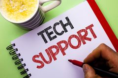 Word writing text Tech Support. Business concept for Help given by technician Online or Call Center Customer Service written by Ma. N Notebook Book Holding Stock Photos