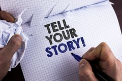 Word writing text Tell Your Story Motivational Call. Business concept for Share your experience motivate world written by Man on T. Word writing text Tell Your royalty free stock photo