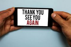Word writing text Thank You See You Again. Business concept for Appreciation Gratitude Thanks I will be back soon Human hand hold. Smartphone with red and black royalty free stock images