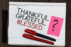 Word writing text Thankful Grateful Blessed. Business concept for Appreciation gratitude good mood attitude Color pen on written n. Otepad with question mark stock photo
