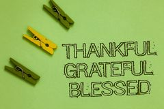 Word writing text Thankful Grateful Blessed. Business concept for Appreciation gratitude good mood attitude Outline words green mi. Ddle yellow paper clip on royalty free stock photos