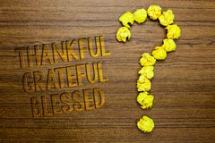 Word writing text Thankful Grateful Blessed. Business concept for Appreciation gratitude good mood attitude Wooden floor with some. Letters yellow paper lumps stock photography