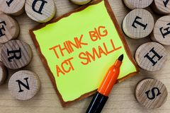 Word writing text Think Big Act Small. Business concept for Great Ambitious Goals Take Little Steps one at a time.  royalty free stock photography