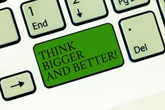 Word writing text Think Bigger And Better. Business concept for Have more great successful ideas Development Keyboard. Key Intention to create computer message royalty free stock photography