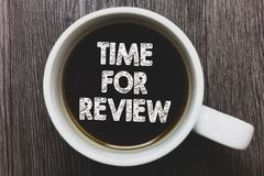 Word writing text Time For Review. Business concept for Evaluation Feedback Moment Performance Rate Assess Black coffee with coffe. E mug floating texts on gray stock photo
