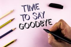 Word writing text Time To Say Goodbye. Business concept for Separation Moment Leaving Breakup Farewell Wishes Ending written by Ma. N plain background holding Stock Image