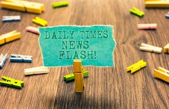 Word writing text Daily Times News Flash. Business concept for fast response to actions happened in article way Clothespin holding. Turquoise paper note several Stock Image