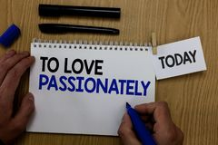 Word writing text To Love Passionately. Business concept for Strong feeling for someone or something else Affection Hand hold pen. Notepad with words paperclip Royalty Free Stock Images