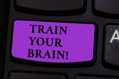 Word writing text Train Your Brain. Business concept for Educate yourself get new knowledge improve skills Keyboard key. Word writing text Train Your Brain stock photography