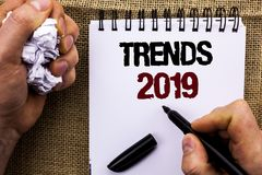 Word writing text Trends 2019. Business concept for Current Movement Latest Branding New Concept Prediction written by Man Holding. Marker Notebook Book the royalty free stock images