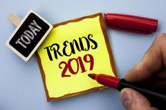 Word writing text Trends 2019. Business concept for Current Movement Latest Branding New Concept Prediction written by Man Holding. Marker Sticky Note Paper the royalty free stock images