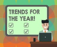 Word writing text Trends For The Year. Business concept for Modern trendy styles new designs fashion industry Blank. Bordered Board behind Man Sitting Smiling vector illustration