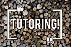 Word writing text Tutoring. Business concept for Mentoring Teaching Instructing Preparing Supporting Give lessons Wooden royalty free stock photo