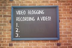 Word writing text Video Blogging Recording A Video. Business concept for Social media networking blogger influence. royalty free stock image