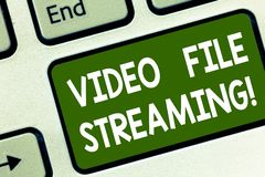 Word writing text Video File Streaming. Business concept for video be viewed online without being downloaded Keyboard stock images