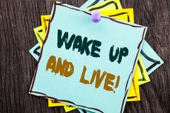 Word, writing, text  Wake Up And Live. Business concept for Motivational Success Dream Live Life Challenge written on Blue Sticky. Word, writing, text  Wake Up Stock Photo