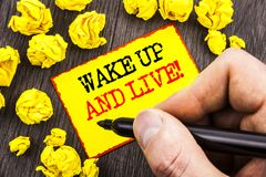 Word, writing, text  Wake Up And Live. Business concept for Motivational Success Dream Live Life Challenge written By Man Holding. Marker Sticky Note Paper Stock Image