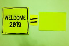 Word writing text Welcome 2019. Business concept for New Year Celebration Motivation to Start Cheers Congratulations Green paper n. Otes reminders equal sign stock photo
