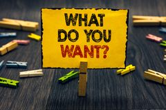Word writing text What Do You Want question. Business concept for Tell me your desires requests demands ambition Blacky wooden des. K laid paper clip randomly royalty free stock photos