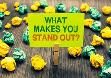 Word writing text What Makes You Stand Out question. Business concept for asking someone about his qualities Clothespin holding ye. Llow note paper crumpled Stock Images