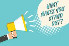 Word writing text What Makes You Stand Out question. Business concept for asking someone about his qualities Man holding megaphone. Loudspeaker speech bubble Stock Image