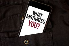 Word writing text What Motivates You Question. Business concept for Passion Drive Incentive Dream Aspiration Cell phone black colo. R frontal pocket show stock images