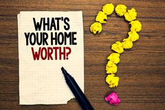 Word writing text What s is Your Home Worth question. Business concept for Value of a house Property Cost Price Rate Written torn. Page touch black pen yellow stock photography