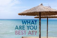 Word writing text What Are You Best At Question. Business concept for Individual creativity is a unique capability Blue beach wate. R Thatched Straw Umbrellas royalty free stock photo