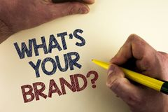 Word writing text What Is Your Brand Question. Business concept for Define Individual trademark Identify Company written by man on stock images