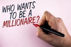 Word writing text who Wants To Be A Millionaire Question. Business concept for Earn more money applying knowledge written by Man h. Olding Marker in Hand plain Royalty Free Stock Photography