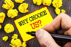 Word, writing, text Why Choose Us Question. Business concept for Reason Of Choice Customer Satisfaction Advantage written By Man. Holding Marker Sticky Note stock images