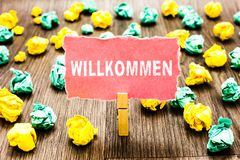 Word writing text Willkommen. Business concept for welcoming people event or your home something to that effect Clothespin holding royalty free stock image