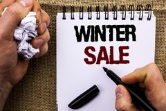 Word writing text Winter Sale. Business concept for Promotion Offer Shop Discount Season Offers Auction Deal Objective written by. Man Holding Marker Notebook Royalty Free Stock Images