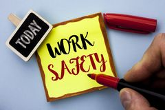 Word writing text Work Safety. Business concept for Caution Security Regulations Protection Assurance Safeness written by Man Hold. Ing Marker Sticky Note Paper Royalty Free Stock Photos