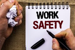 Word writing text Work Safety. Business concept for Caution Security Regulations Protection Assurance Safeness written by Man Hold. Ing Marker Notebook Book the Stock Images