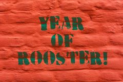 Word writing text Year Of Rooster. Business concept for Chinese horoscope zodiac sign China traditional celebration. Brick Wall art like Graffiti motivational royalty free stock photos
