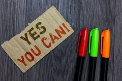 Word writing text Yes You Can. Business concept for Positivity Encouragement Persuade Dare Confidence Uphold Paperboard Important. Reminder Communicate ideas stock image